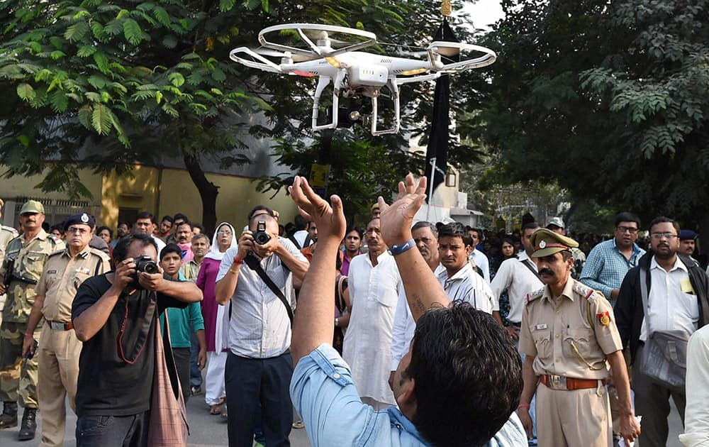 Police using a Drone to keep a watch on a Muharram procession in tension hit Trilokpuri in New Delhi.