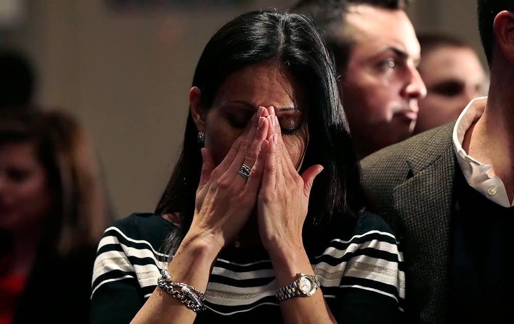 Jahala Grous, of Essex, Conn., cries as incumbent Democratic Gov. Dannel Malloy is shown addressing supporters on a television screen at an election night party for Republican candidate for governor Tom Foley, in Old Greenwich, Conn.
