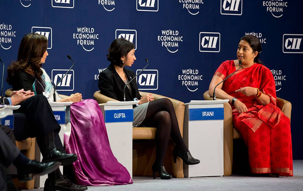 Indian Minister for Human Resource Development Smriti Irani, right, speaks during a panel discussion at the India Economic Summit in New Delhi, India.