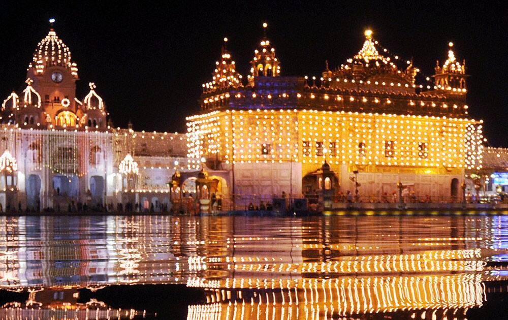 Golden Temple is illuminated on the eve of the birth anniversary of Guru Nanak Dev Ji in Amritsar.