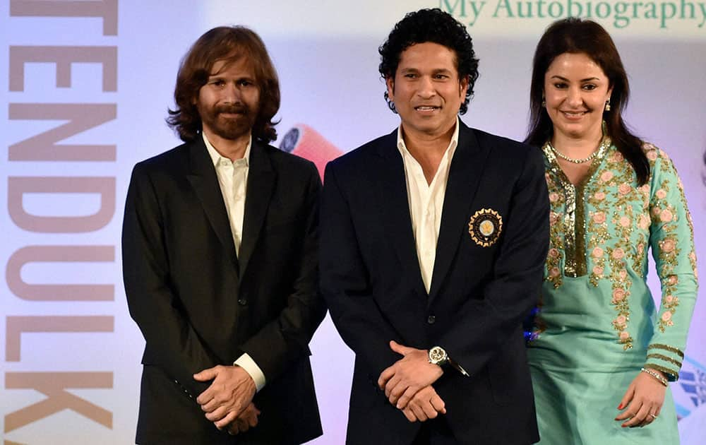 Cricket legend Sachin Tendulkar with wife Anjali and elder brother Ajit Tendulkar during the release of his autobiography Playing It My Way in Mumbai.