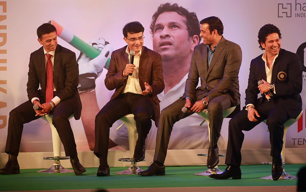 Retired cricket great Sachin Tendulkar, shares a lighter moment with former cricketers Rahul Dravid, Saurav Ganguly and VVS Laxman during the launch of his autobiography, 'Playing It My Way,' in Mumbai.