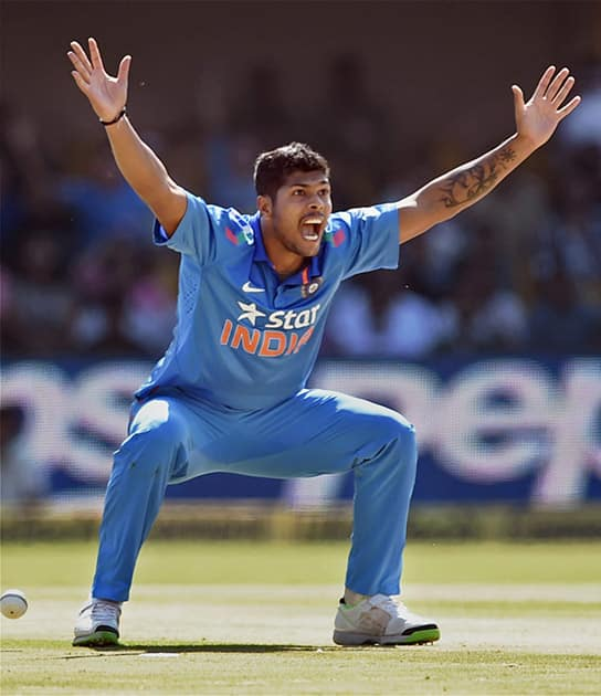 Umesh Yadav celebrates after taking the wicket of Srilankan batsman Kusal Parera during the India VS Sri Lanka ODI match in Ahmedabad.