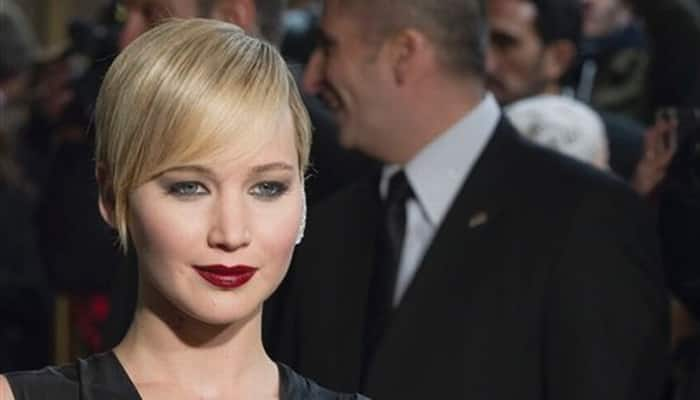 Chris Martin to join Jennifer Lawrence at 'Hunger Games' premiere?