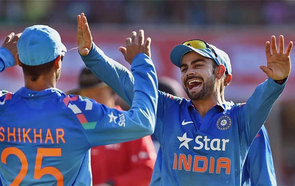 Indian captain Virat Kohli celebrates the wicket of Sri Lankan batsman Sangakkara during the ODI cricket match in Ahmedabad.