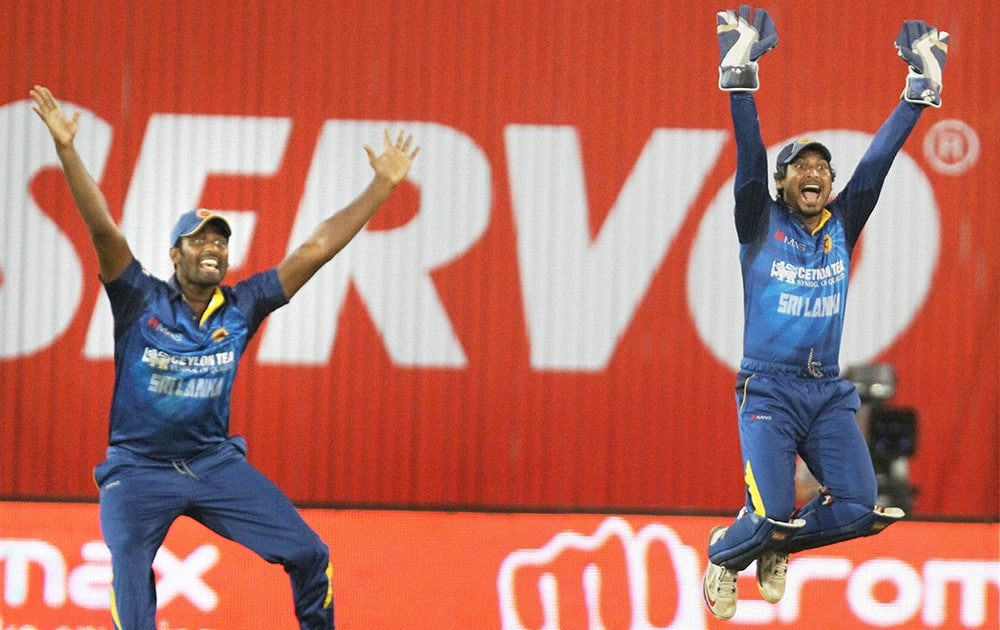 Sri Lankan team players appeal for the wicket of Indian Batsman Shikar Dhawan during the 2nd ODI cricket match in Ahmedabad.