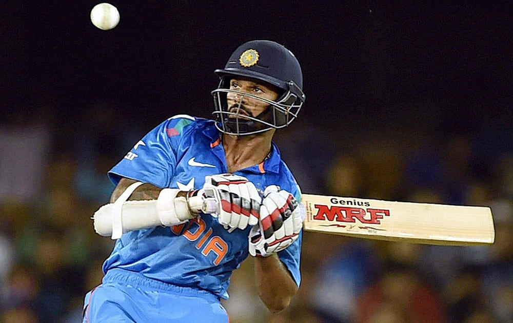 Shikhar Dhawan plays a shot during the 2nd ODI cricket match against Sri Lanka in Ahmedabad.