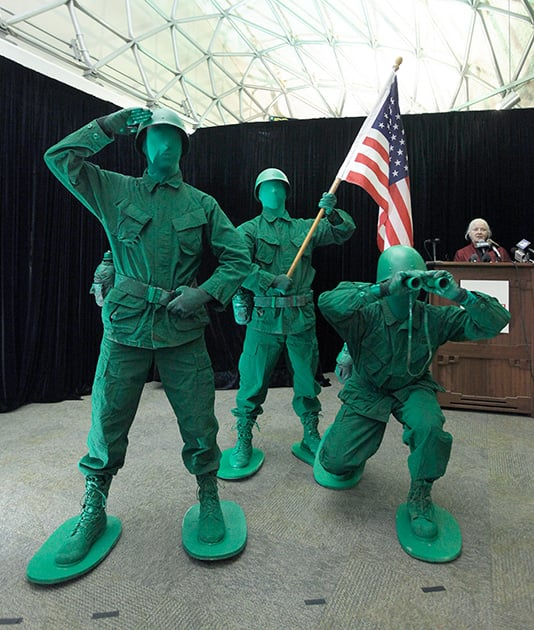 Actors portraying little green army men pose at the National Museum of Play at The Strong, in Rochester, N.Y. The molded plastic must-haves for generations of pretend soldiers were inducted into the National Toy Hall of Fame on Thursday, along with the 1980s stumper Rubik's Cube, and bubbles.