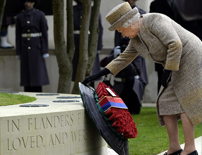 Britains Queen Elizabeth places a wreath during the inauguration of the Flanders Fields Memorial Garden.