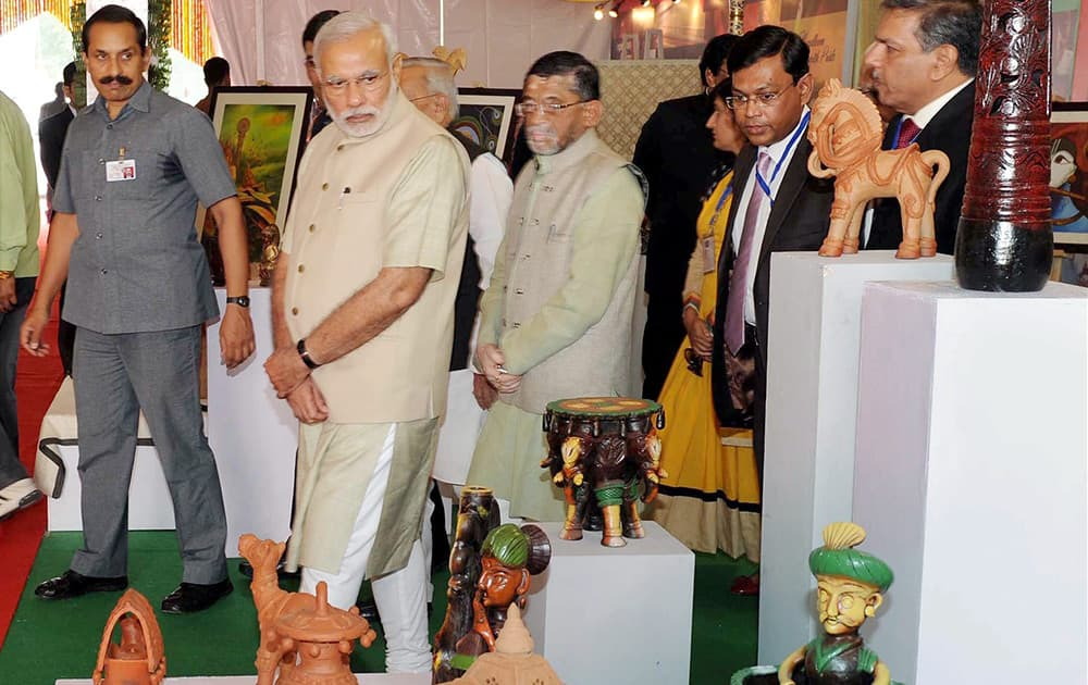 Prime Minister Narendra Modi visits an exhibition during foundation stone laying ceremony of Trade Facilitation Center and Crafts Museum and inauguration of Powerloom Service Center, in Varanasi.