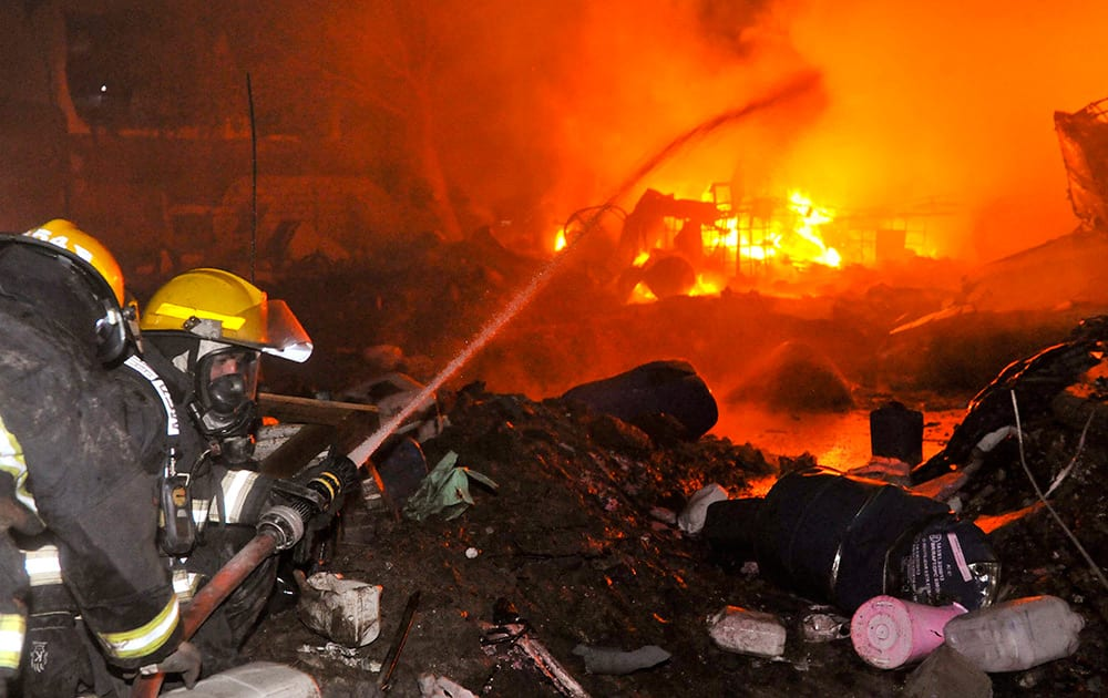 Firemen douse flames emerging from the Rigoni chemical factory in Cordoba, Argentina. According to the provincial Health Minister Francisco Fortuna, more than 60 people were injured due to the explosion at the chemical plant in the province of Cordoba, Thursday night.