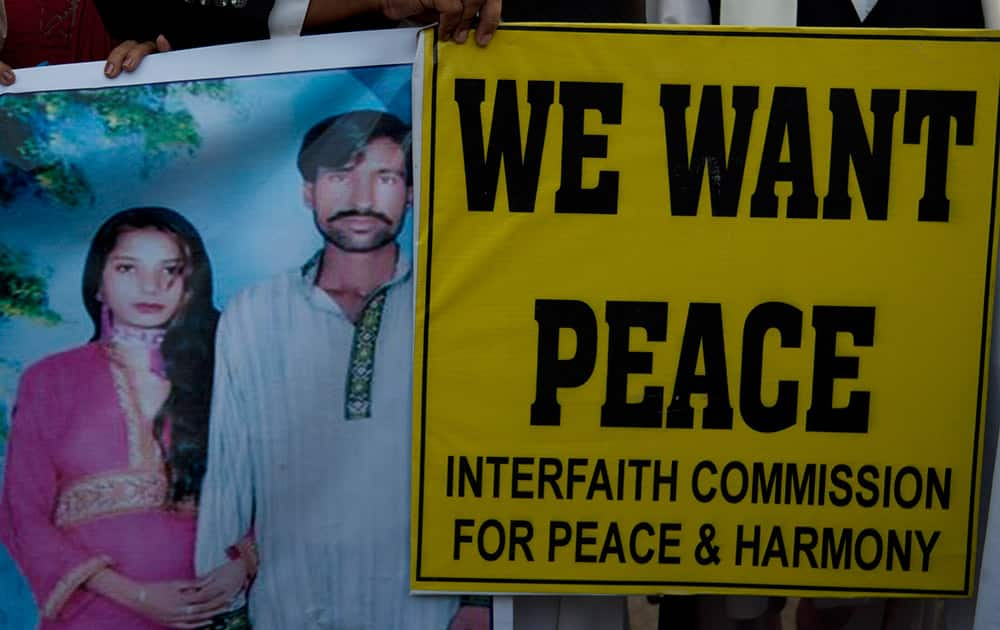 Pakistani human rights activists hold a picture of a Christian couple during a demonstration in Karachi, Pakistan.