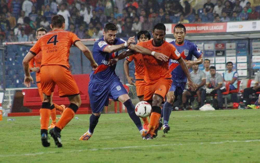 Mumbai City FC and Delhi Dynamos FC players in action during the Indian Super League match.