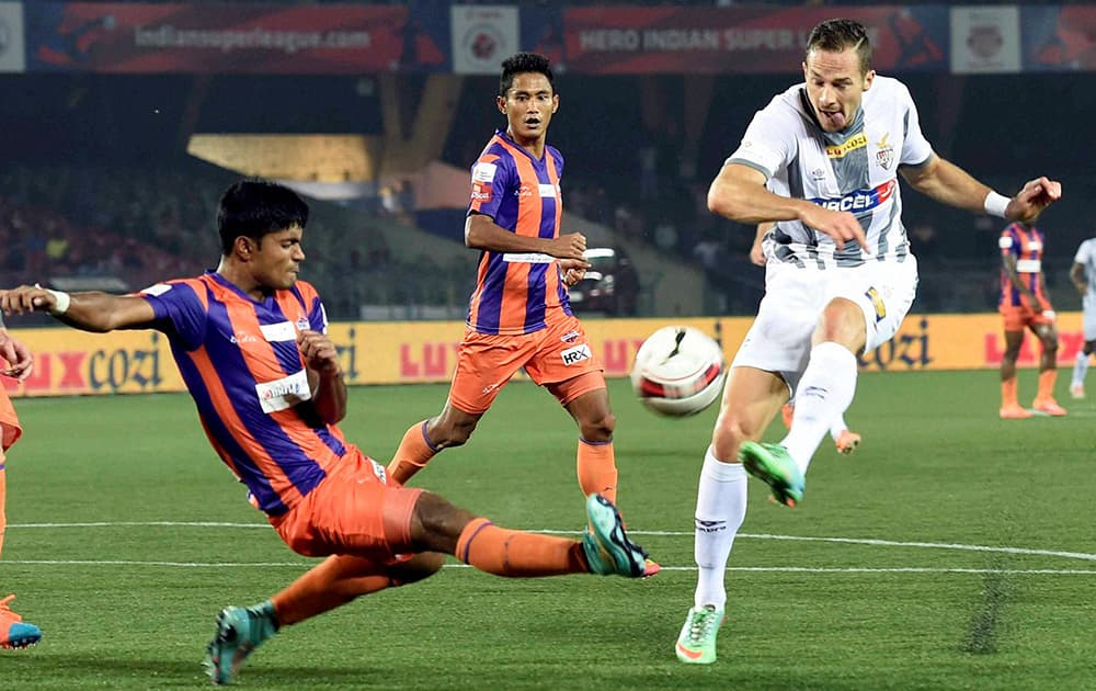 Atletico de Kolkata( white) and FC Pune City players in action during their ISL match in Kolkata.