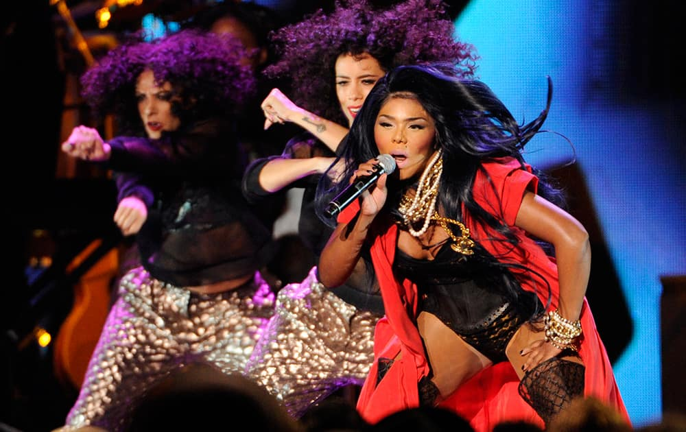 Lil' Kim performs during a tribute to honorees Kool & The Gang during the 2014 Soul Train Awards at Orleans Arena in Las Vegas.