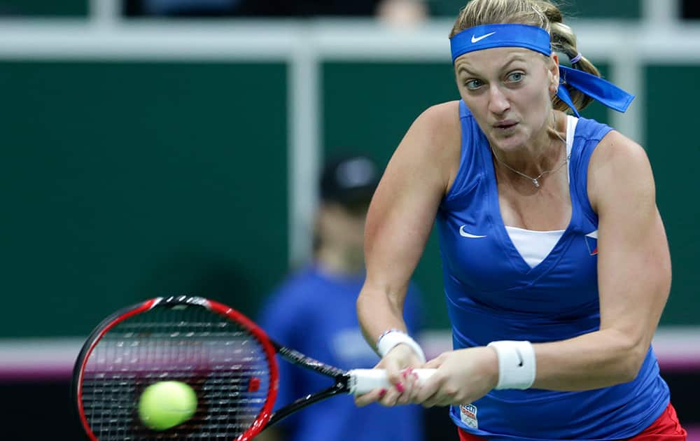 Czech Republic's Petra Kvitova returns a ball to Germany's Andrea Petkovic during their Fed Cup Final tennis match between Czech Republic and Germany in Prague, Czech Republic.