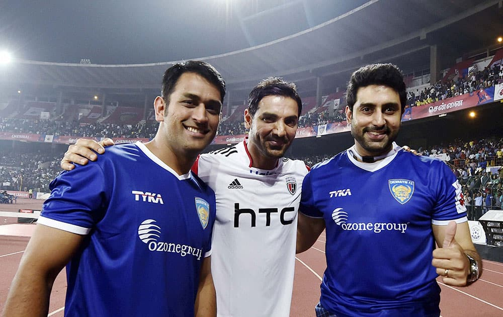 CHENNAIYIN FC CO-OWNERS MS DHONI, ABHISHEK BACHCHAN AND NORTHEAST UNITED FC CO-OWNER JOHN ABRAHAM SHARE A LIGHT MOMENT DURING THE INDIAN SUPER LEAGUE MATCH BETWEEN CHENNAIYIN FC AND NORTHEAST UNITED FC, IN CHENNAI.