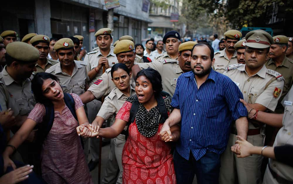 Activists expressing support to the 'Kiss of Love' campaign  lock hands and shout slogans after police prevented them from marching towards the Hindu right-wing Rashtriya Swayamsevak Sangh (RSS) headquarters in New Delhi.