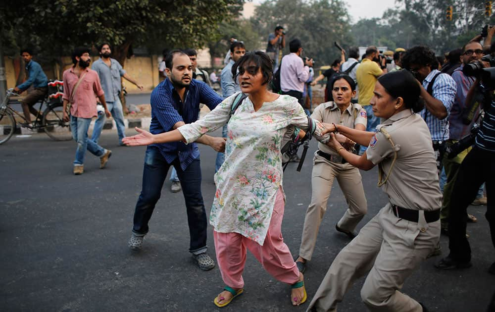 Policewomen prevent an activists expressing support to the 'Kiss of Love' campaign  from marching towards the Hindu right-wing Rashtriya Swayamsevak Sangh (RSS) headquarters in New Delhi.