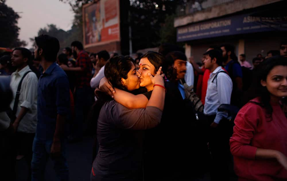 Indian women kiss each other to express support to the 'Kiss of Love' campaign near the Hindu right-wing Rashtriya Swayamsevak Sangh (RSS) headquarters in New Delhi.