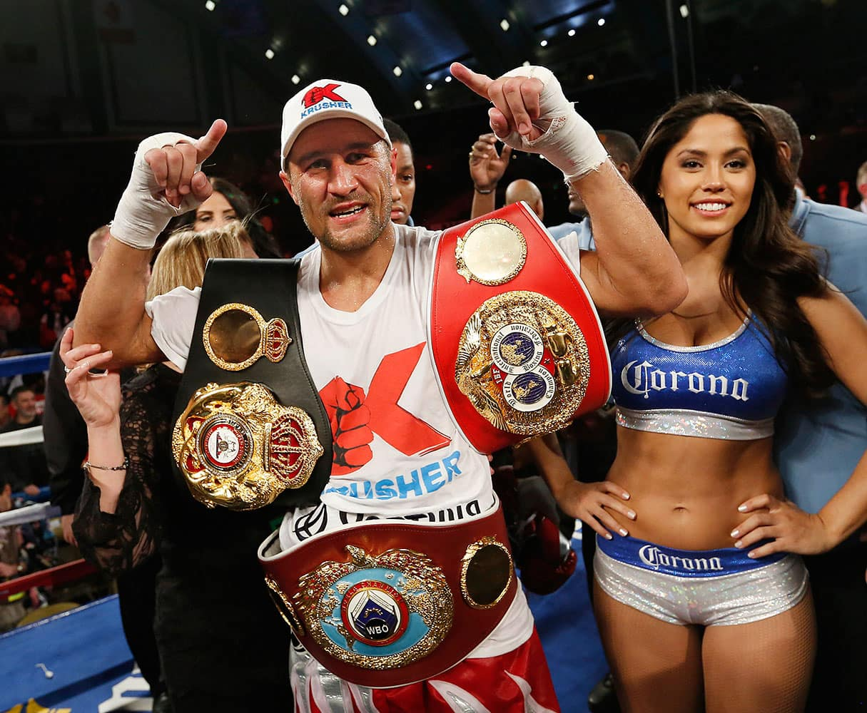 Sergey Kovalev of Russia poses with the belts after beating Bernard Hopkins of Philadelphia, PA in the 12th round of the Main Event IBF, WBA and WBO Light Heavyweight Titles boxing in Atlantic City, N.J.