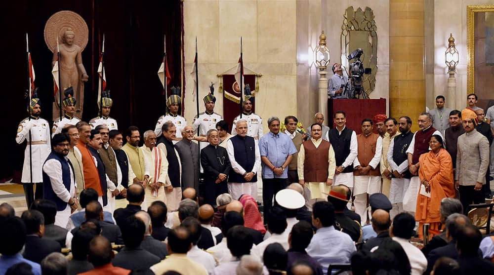 President Pranab Mukherjee, Vice President Hamid Ansari and Prime Minister Narendra Modi with the newly sworn-in ministers at their oath taking ceremony at Rashtrapati Bhavan in New Delhi.