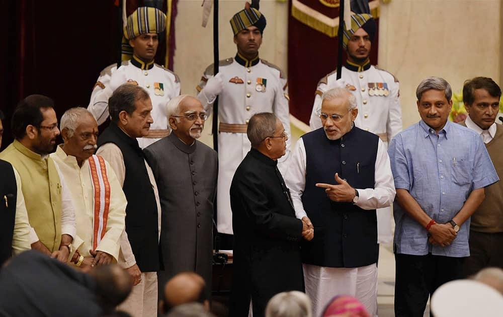 President Pranab Mukherjee and Prime Minister Narendra Modi with the newly sworn-in minister Manohar Parrikar at the swearing-in ceremony at Rashtrapati Bhavan in New Delhi.