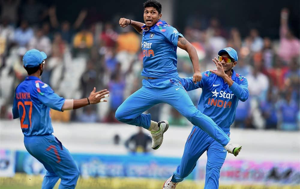 Indian bowler Umesh Yadav with team mates celebrates the wicket of Sri Lanka's K Sangakkara during 3rd ODI cricket match in Hyderabad.
