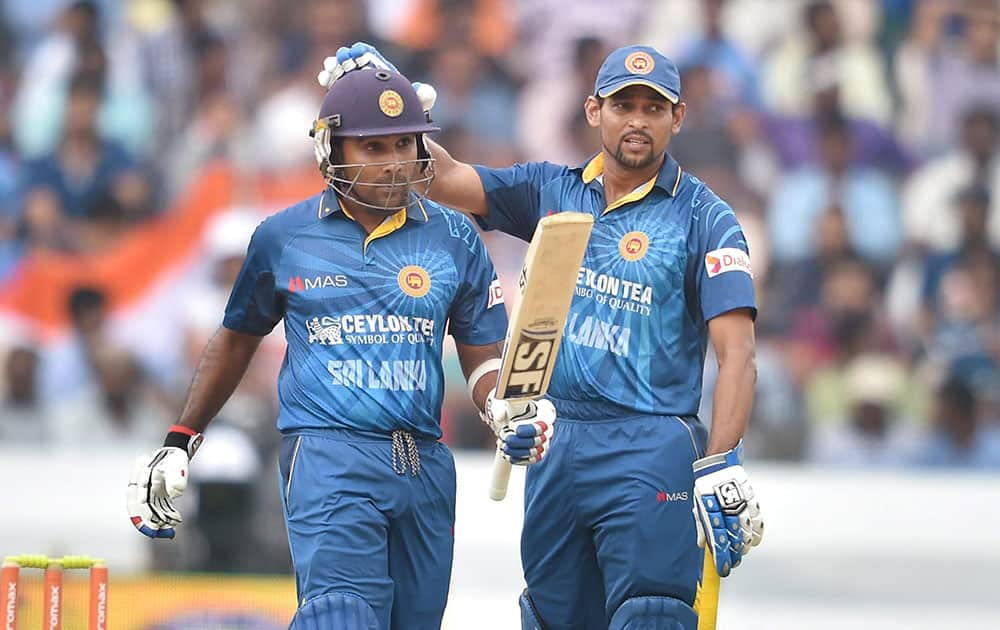SriLanka's Mahela Jayawardene celebrates his fifty runs against India during 3rd ODI cricket match in Hyderabad.
