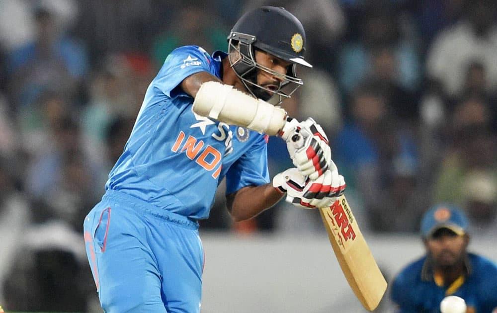 Shikhar Dhawan plays a shot against Sri Lanka in the third ODI in Hyderabad