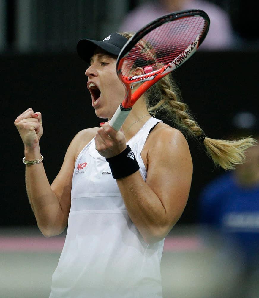 Germanys Angelique Kerber reacts after winning a point against Czech Republics Petra Kvitova during their Fed Cup Final tennis match between Czech Republic and Germany in Prague, Czech Republic.