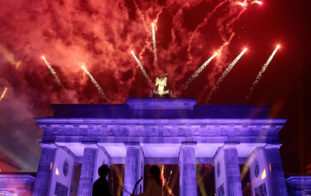 Fireworks explode behind Brandenburg Gate during the central event to commemorate the Fall of the Wall in Berlin.