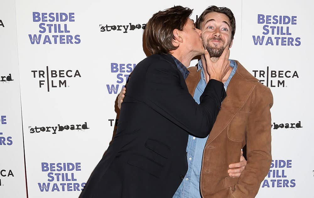 Filmmaker Chris Lowell, left, and actor Ryan Eggold attend the premiere of `Beside Still Waters` at the Sunshine Landmark Theater  in New York.