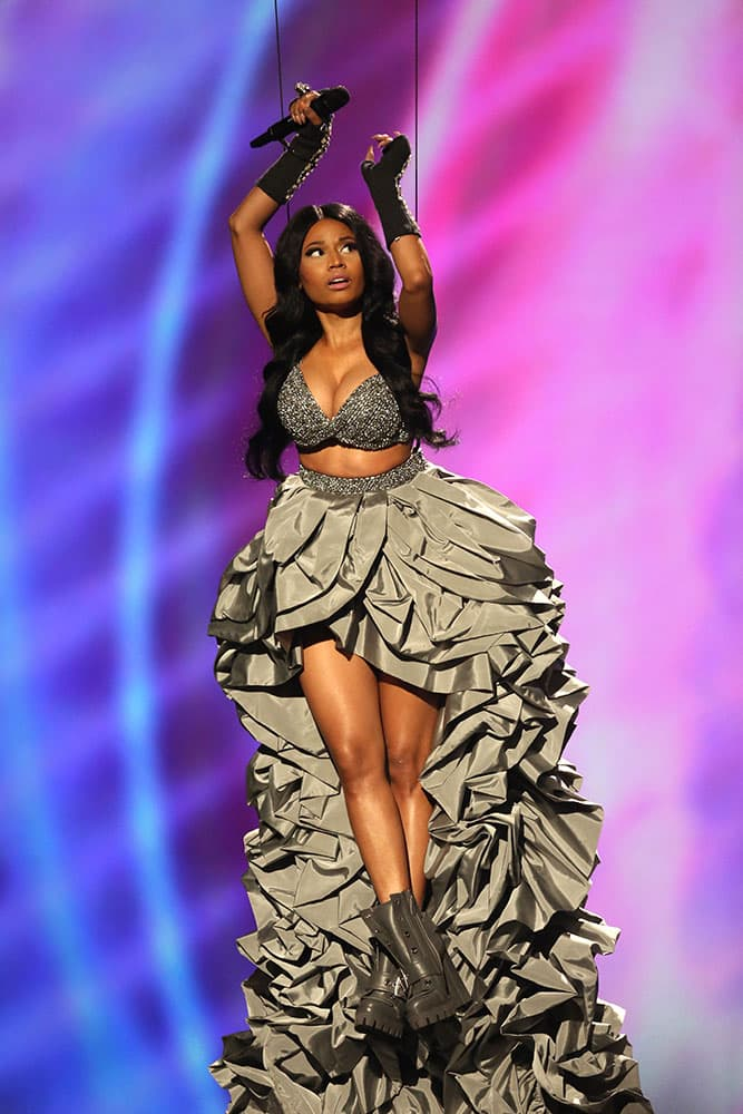 Host Nicki Minaj is lowered into the auditorium held by wires during the 2014 MTV European Music Awards in Glasgow.