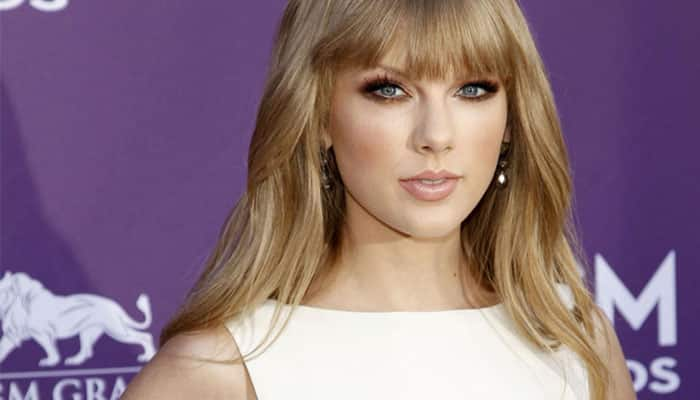 I am lucky Taylor Swift writes songs about me: Harry Styles