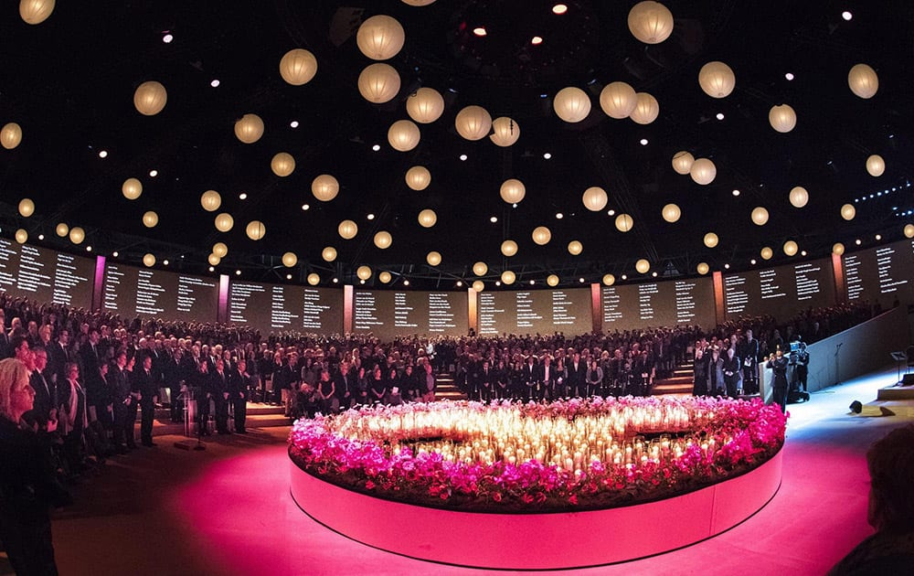 Grieving family members and friends of victims of the Malaysia Airlines Flight 17 disaster gathered around 298 candles representing the victims during a national commemoration ceremony in Amsterdam.