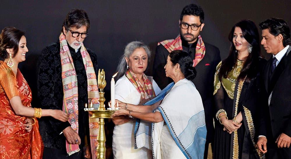 West Bengal Chief Minister Mamata Banerjee (C) along with actors (L-R) Raima Sen, Amitabh Bachchan, MP Jaya Bachchan, Abhishek Bachchan, Aishwarya Rai Bachchan and Shahrukh Khan during inauguration of 20th Kolkata International Film Festival.