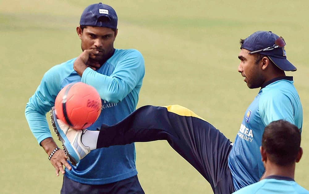 Sri Lankan cricketers playing soccer during a training session at Eden Garden in Kolkata.