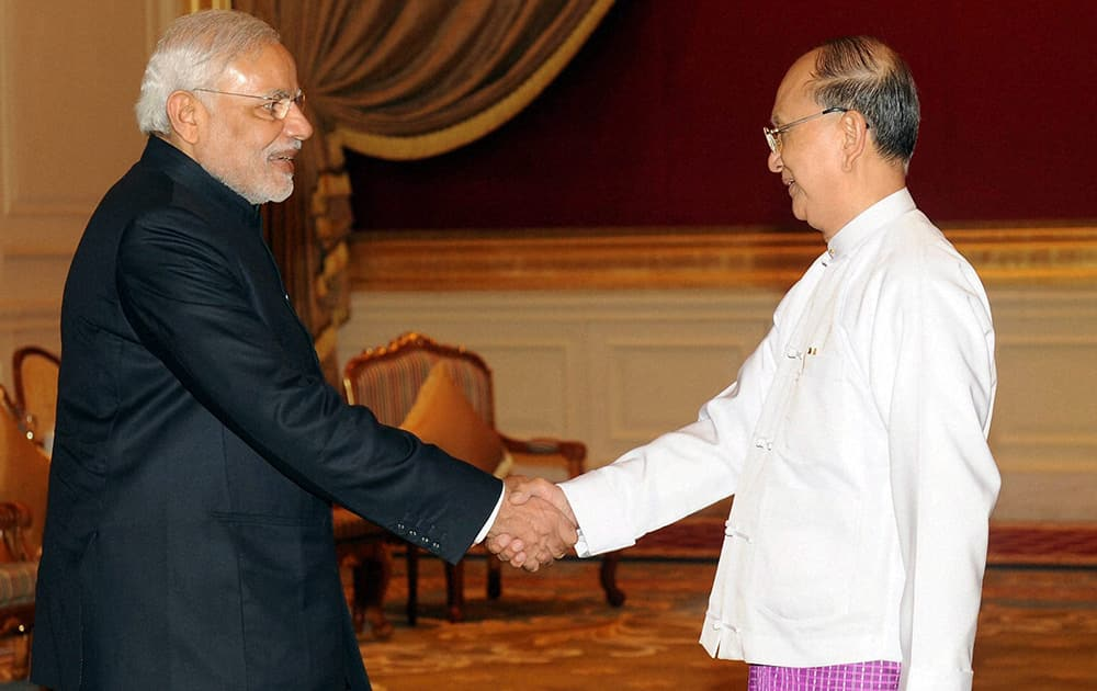Prime Minister Narendra Modi shakes hands with President of Myanmar, U Thein Sein during a meeting at Presidential Palace in Myanmar.