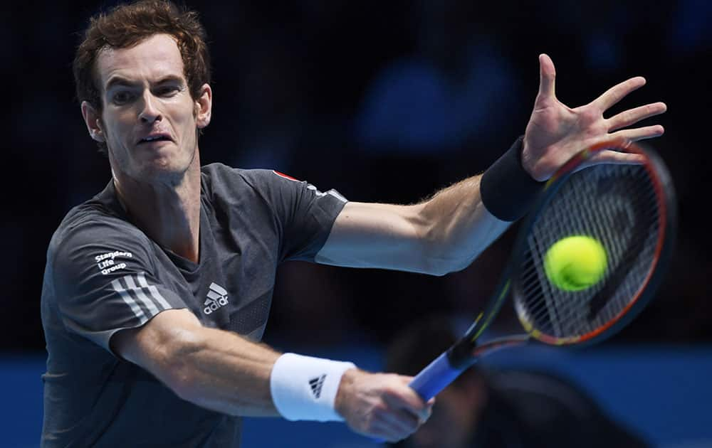 Britain's Andy Murray plays a return to Canada's Milos Raonic during their singles ATP World Tour tennis finals match at the O2 arena in London.