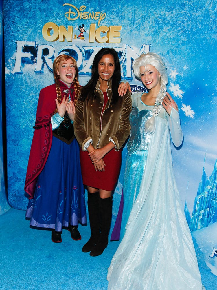 Padma Lakshmi, center, poses with dancers from Disney On Ice presents Frozen at the Barclays Center in New York.