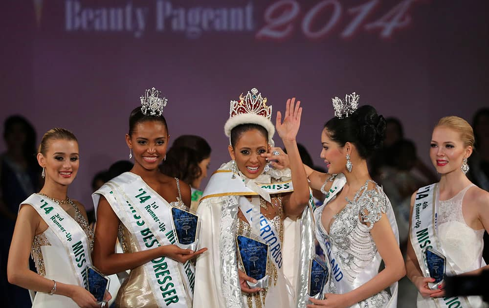 Newly-crowned Miss International Valerie Hernandez Matias, center, of Puerto Rico waves with her runners-up, from left, third runner-up Victoria Charlotte Tooby of Great Britain, first runner-up Zuleika Suarez of Colombia, second runner-up Punika Kulsoontornrut of Thailand and forth runner-up Milla Romppanen of Finland, after the final of Miss International Beauty Pageant in Tokyo.