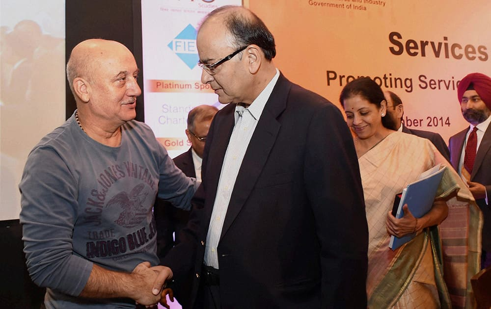 Finance Minister Arun Jaitley with actor Anupam Kher at the opening session of Services Conclave 2014 in New Delhi.