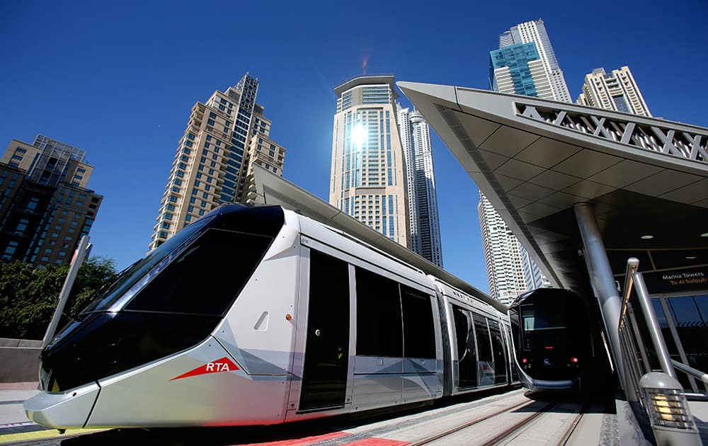 A tram leaves Marina Towers station during the first day of operation in Dubai, United Arab Emirates. The Mideast commercial hub of Dubai opened its first tram line on Wednesday, enticing would-be riders with air-conditioned platforms and a premium section on its sleek cars for those willing to spend a few more dirhams.