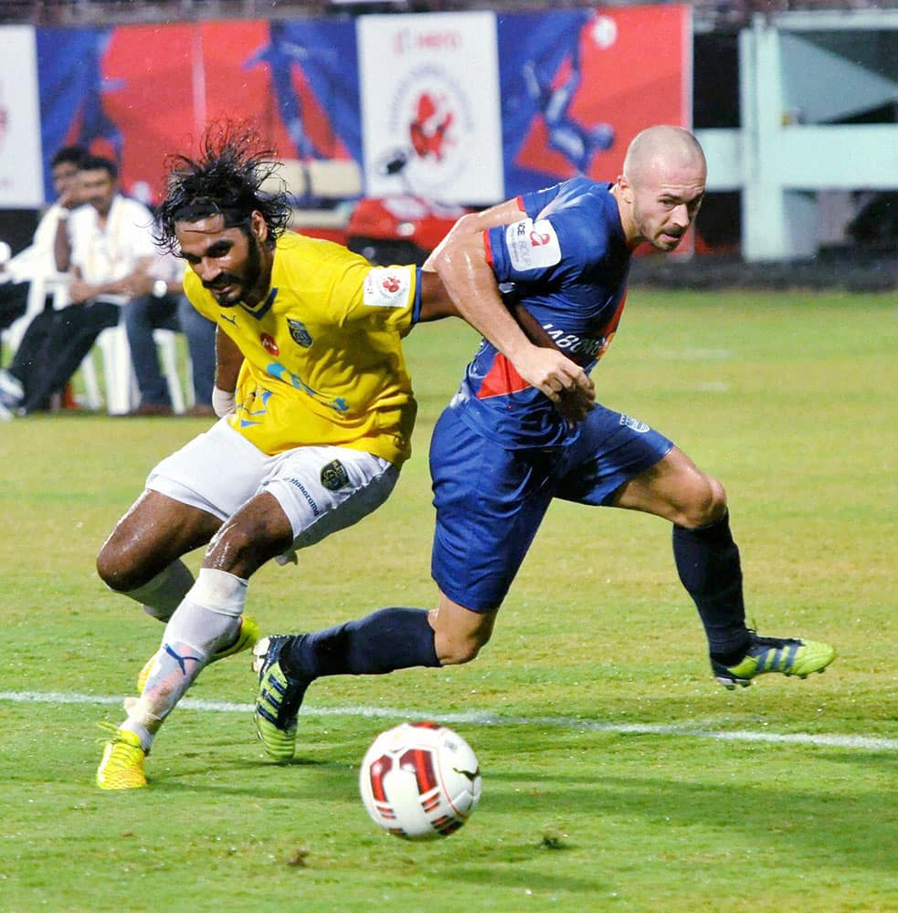 Kerala blasters FC (Yellow) and Mumbai City FC (Blue) players in action during the ISL match in Kochi.