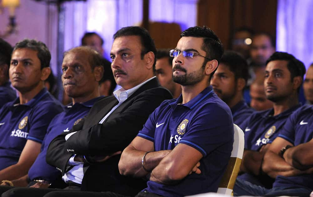 Indias captain Virat Kohli along with teammates and officials listen to VVS Laxman former Indian cricketer as the latter delievers a lecture during the 3rd annual Pataudi-Memorial-Lecture in Kolkata.