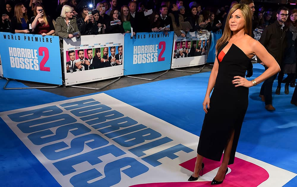 Actress Jennifer Aniston poses for photographers at the World Premiere of Horrible Bosses 2 at a central London cinema.