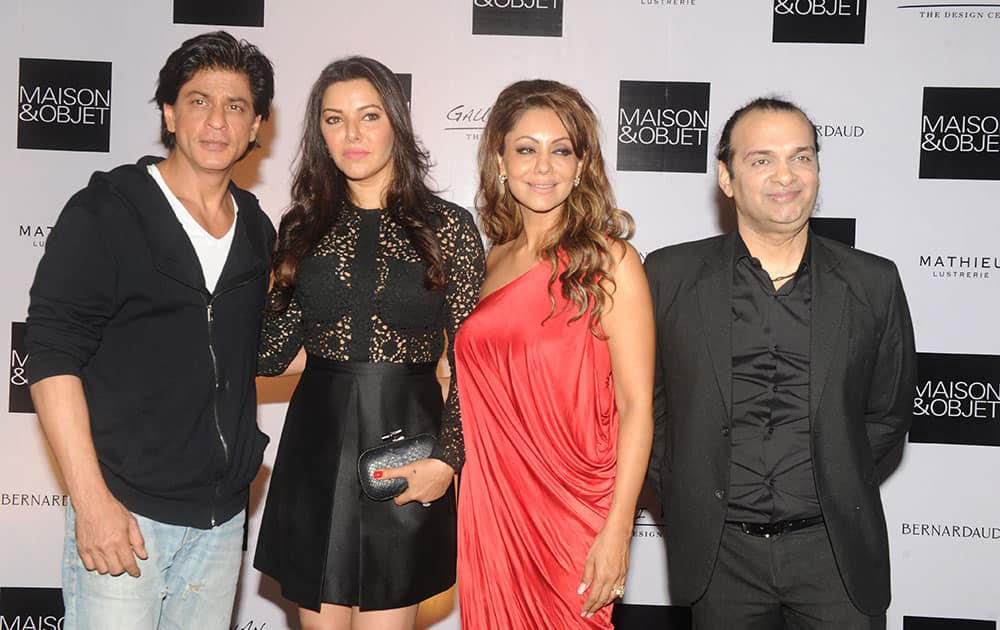 (L-R) Shah Rukh Khan, Kaykasshan Patel, Gauri Khan and Raj Anand at Gauri Khan's cocktail party at her new store The Design Cell in Mumbai. DNA