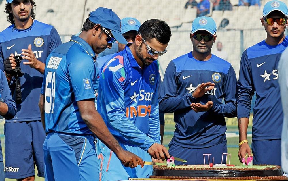 Virat Kohli and Sri Lankan captain Angelo Mathews cutting a cake to celebrate 150 years of Eden Garden, in Kolkata.