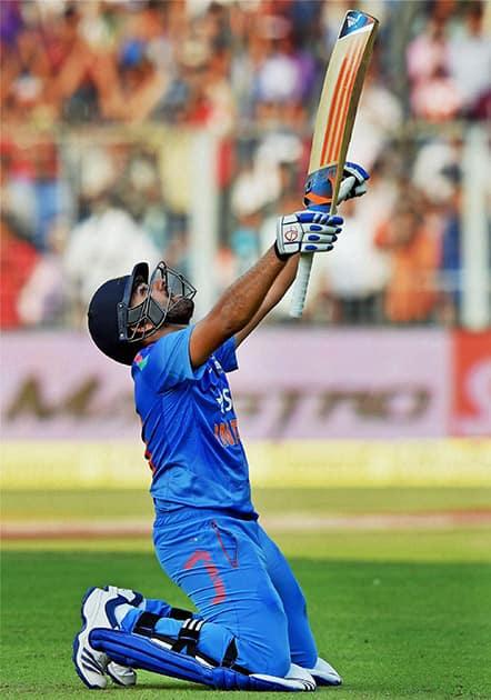 Rohit Sharma celebrates his century during 4th ODI cricket match against Sri Lanka at Eden Garden in Kolkata.